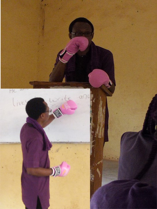 ANSU lecturer wearing gloves